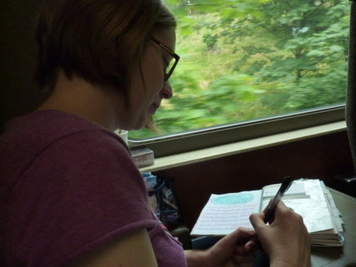 Catherine journaling on the train